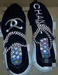 chanel x pharrell adidas. (rendering of the chanel pharrell adidas nmd hu) x a