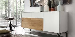 an ancient and modern sideboard made from knotted white wood