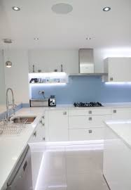 White Gloss Kitchen Nolte Kitchens Glass Splashbacks Lighting And Blue