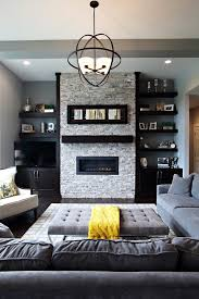 Floating shelves next to fireplace living room transitional with orb  pendant gray tufted ottoman yellow accents