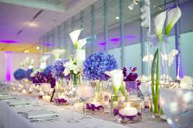 ... Long wedding table with blue hydrangea and purple flowers ...