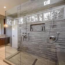 large walk in shower with porcelain tile