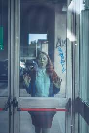 whats behind the green glass door beautiful redhead girl posing behind a glass door stock image image of alone what can go through the green glass