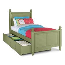 bedroom green wooden single bed with assorted color bed sheet plus storage with trundle placed