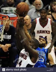 Atlanta Hawks forward Ivan Johnson (44) goes up for two points over Dallas  Mavericks guard Vince