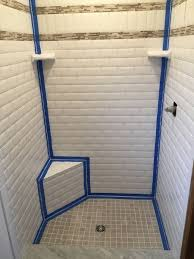 repair tile bathroom wall. avoid cracked grout: caulk tile shower corners repair bathroom wall u