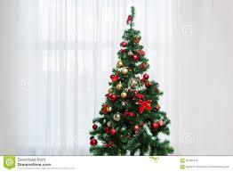 Christmas Tree In Living Room Behind Window Stock Photo  Getty ImagesChristmas Tree In Window