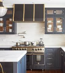 gray cabinets with white marble like countertops