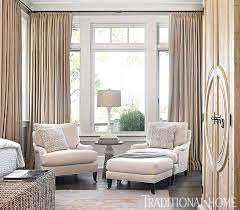 A cozy conversation nook in the bedroom is framed by rich linen drapes. -  Photo