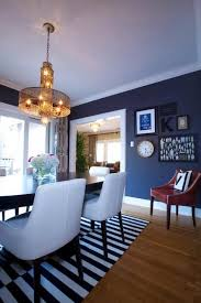 amazing dining room love the bright white chairs with the dark walls