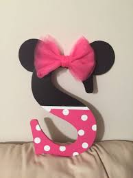 i bought a black letter s and painted the bottom half pink with polka dots ears made of paper with a tulle bow to top it off perfect for a part