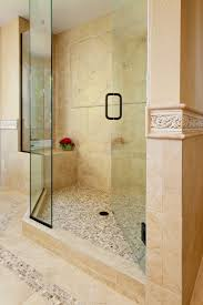 interior beige wall tile connected by glass door with black metal handle contemporary shower