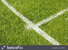 green grass football field.