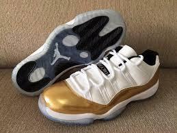 jordan shoes 11 white gold. the air jordan 11 low metallic gold shines in more ways than one shoes white