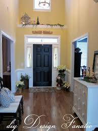 Enchanting Black Painted Front Doors With White Drawers Cabinets Decors And  Two Armless Chairs On Wooden Floors As Inspiring Beautiful Foyer Decorating  ...