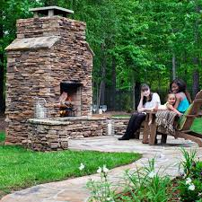 custom outdoor fireplace. this gorgeous natural stone fireplace was custom designed and built by archadeck of charlotte. the · providing additional outdoor