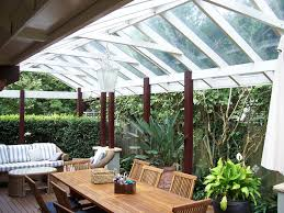 clear covered patio ideas. Pergola Roof Ideas Most Recommended Design Ebony Stained Finish Wooden Posts White Crossbeams Rafters Clear Glass Covered Patio
