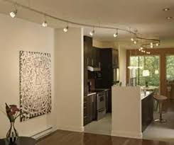 designer track lighting. The Track Works With A Narrow-focus Bulb To Spotlight Piece Of Artwork, Wide-focus \u201cwall Washer\u201d Bathe Wall In Light, Or General-purpose Designer Lighting O