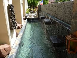 build a fish pond and waterfall wall in