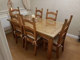 beautiful solid wood dining table with glass protector top and six chairs used 150