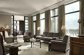 Large transitional formal and enclosed dark wood floor living room photo in  New York with gray