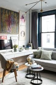 office area in living room. Small Space Secrets: Float Your Furniture. Office SpacesTiny SpacesSmall Living Room Area In