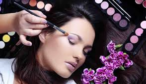 makeup artist applying purple makeup