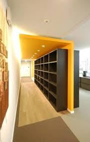 office partition design ideas. semi hidden storage room corporate office shelves for material binders and samples partition design ideas w