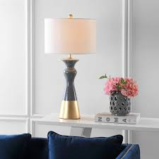 iconic architectural lighting inspired this modern vintage table lamp set of 2 its decadent graphic style boasts a curvaceous geometry illuminated by