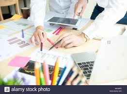 Business Group Working Check Chart And Paper Data With