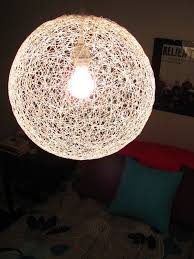 diy string chandelier from a bouncy ball and yarn