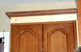 add crown moulding to kitchen cabinets bar cabinet