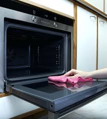 cleaning that brown stained oven door glass women cleaning the oven with towel cleaning that brown cleaning that brown stained oven door glass