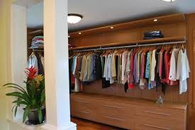 amazing closet design with brown wooden closet cabinet with led lights and wooden floor