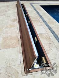 1000 ideas about pool covers swimming pool love the hidden pool cover don t really want a pool cover to be showing does not have to be automated i ve seen the turn ones