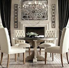 chandelier for dining table c reclaimed pine zinc trestle round dining table chandelier over dining table