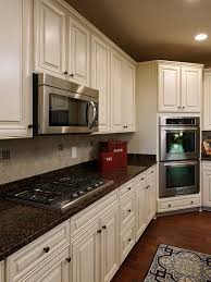 cream and brown kitchen designs. sun down scenic from finland: baltic brown granite white cabinets backsplash ideas. brings some mother nature touch to your kitchen remodeling. cream and designs g