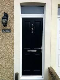 black front door with glass oval til hle