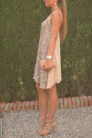 Beige short glossy dress heels and purse. Street summer women.