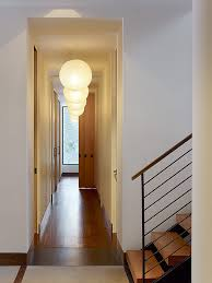 lights and chandeliers can make hallways look brighter