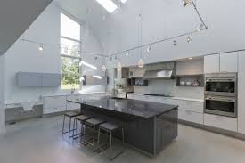 pendant track lighting for kitchen. Striking Grey Kitchen Island White Cabinets With Pendant Track Lighting Fixtures Also Milk Glass For S