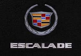 cadillac logo black. silver lettering on black background with crest cadillac logo b