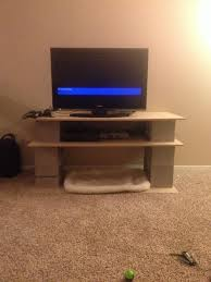 DIY tv stand made outta cinder blocks and wooden board Cheap and easy