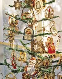 antique paper santa ornaments on a tree