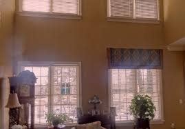 After hanging one of two valances - notice how this softens the two story  room & makes the gap between windows look better