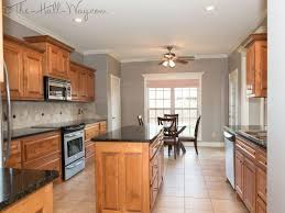 Kitchen w/ Maple Cabinets with Cherry Stain and Mocha Glaze, Uba Tuba  Granite,. Grey Paint ...