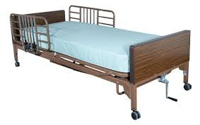 Tag man in hospital bed with full rails at home.