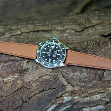 vintage rolex submariner on a smooth french tan barenia from lugs
