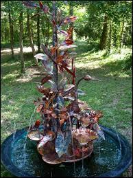 copper magnolia tree with heron