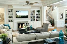 living rooms with tv over fireplace television above a fireplace view in gallery pops of turquoise living rooms with tv over fireplace